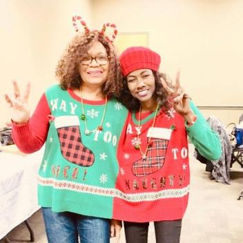 Winners of the Ugly Christmas Sweater Competition, Denise and Mary.